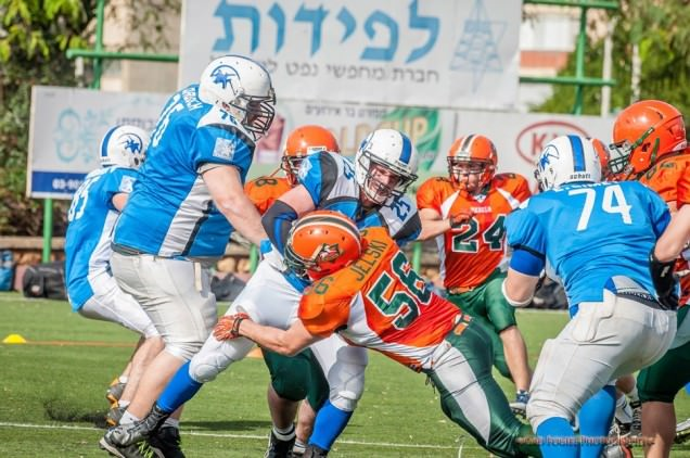 Jason Hess (number 24) and the Judean Rebels of the Israeli tackle football league (IFL) in action. Photo credit: Gad Fogiel Photography